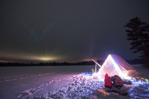 clearwater lodge lit nighttime camping tent